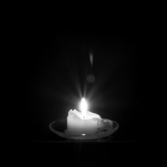 stock-photo-65303619-candle-and-candlelight-in-black-and-white 2